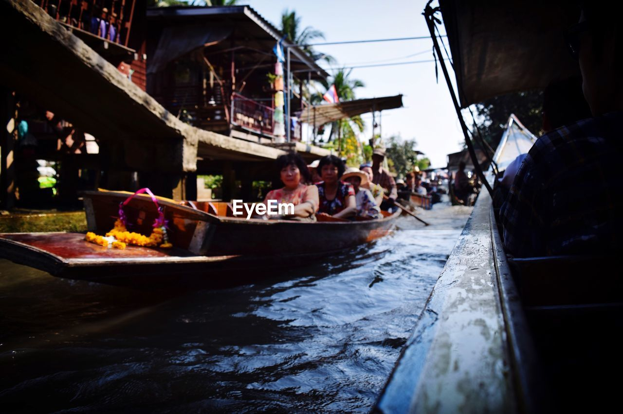 real people, built structure, transportation, day, architecture, men, large group of people, nautical vessel, outdoors, lifestyles, building exterior, women, group of people, food, water, sky, people