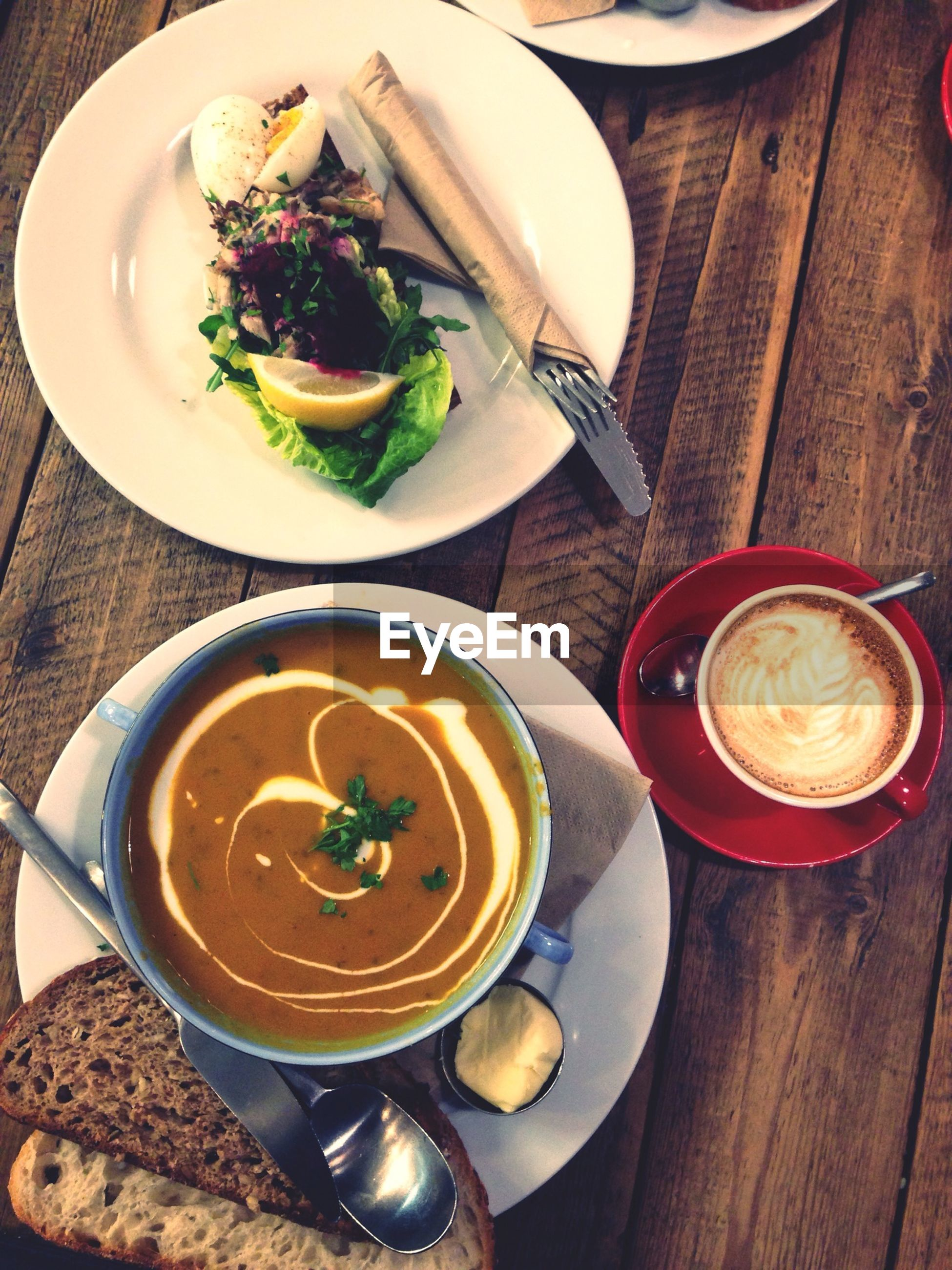 food and drink, freshness, table, indoors, food, plate, drink, ready-to-eat, still life, healthy eating, refreshment, serving size, high angle view, meal, spoon, bowl, served, wood - material, coffee cup, close-up