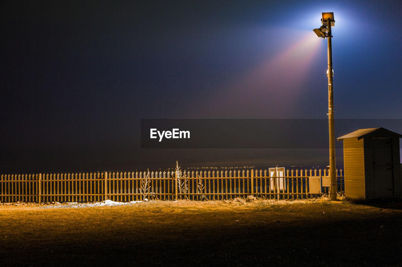 Illuminated Fog Against Sky At Night