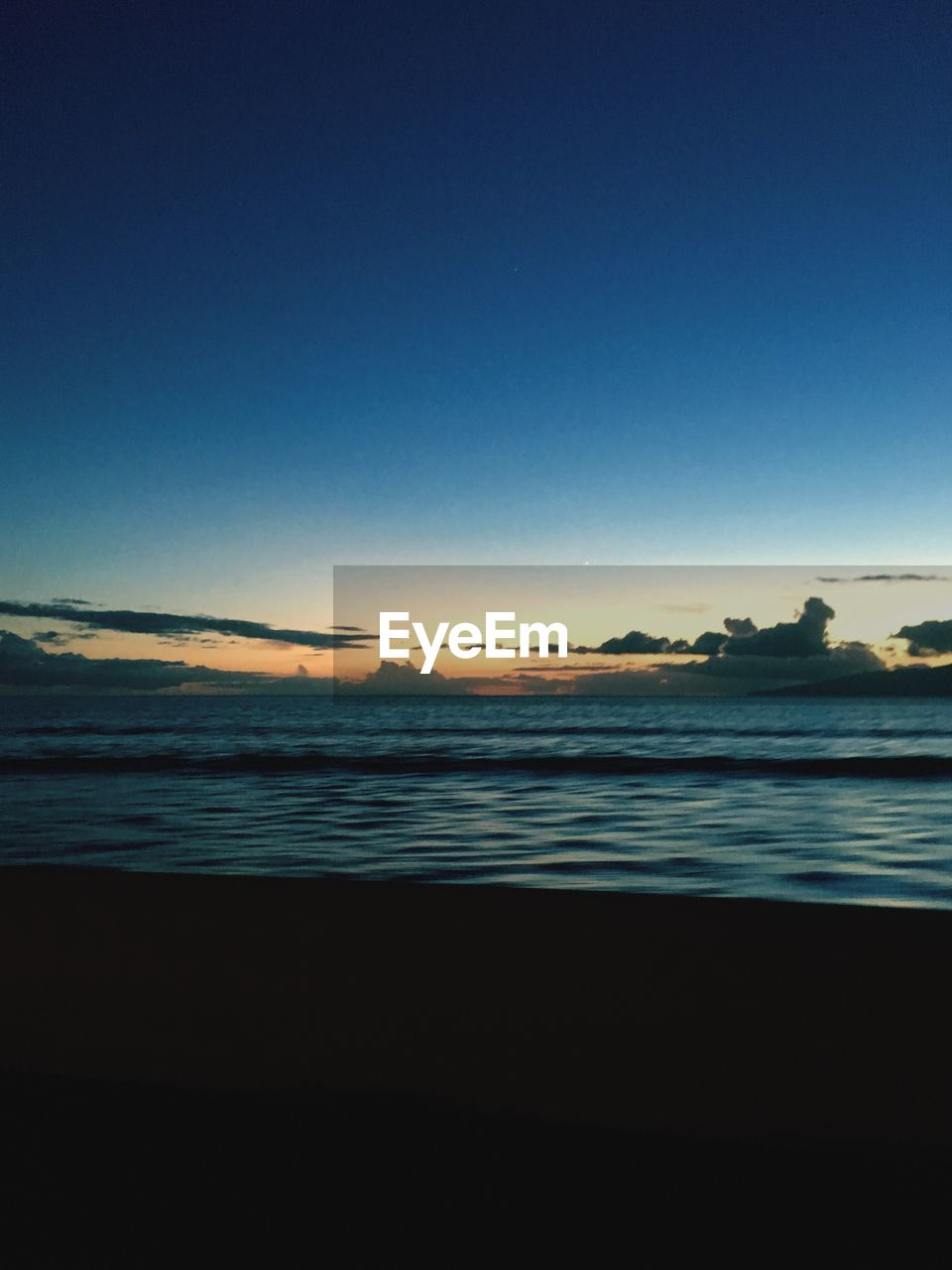 sky, scenics - nature, beauty in nature, tranquility, water, sea, tranquil scene, copy space, land, beach, clear sky, no people, nature, blue, idyllic, outdoors, non-urban scene, sunset, horizon