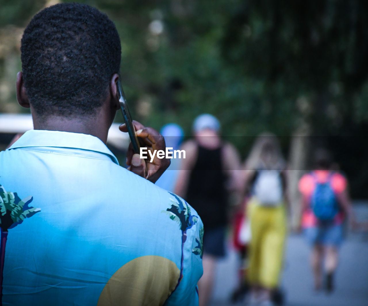 REAR VIEW OF PEOPLE AT MUSIC FESTIVAL