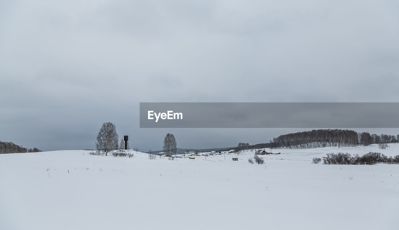 sky, cold temperature, winter, beauty in nature, scenics - nature, cloud - sky, snow, nature, tranquility, tranquil scene, environment, day, land, landscape, non-urban scene, field, no people, architecture, outdoors