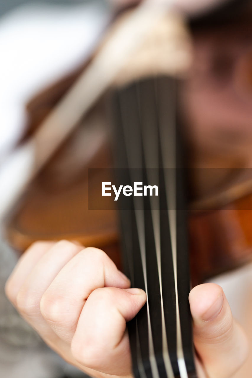 Cropped hand playing violin