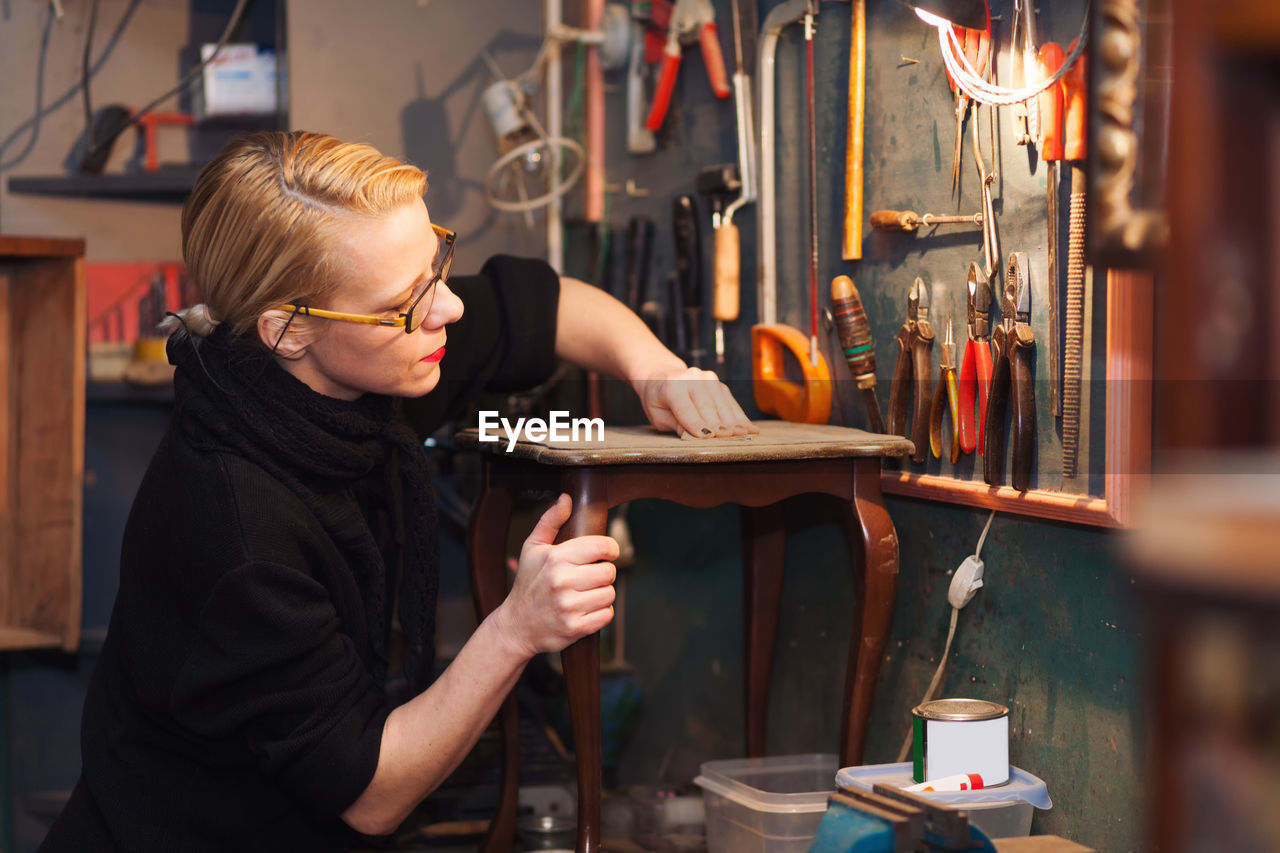 Mature Woman In Workshop