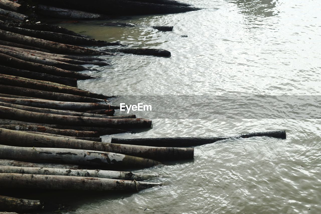 water, nautical vessel, transportation, no people, day, nature, sea, mode of transportation, wooden raft, waterfront, outdoors, high angle view, tranquility, wood - material, reflection, tranquil scene, scenics - nature, oar
