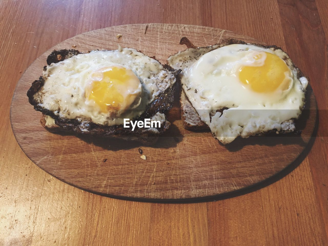High angle view of fried eggs on breads