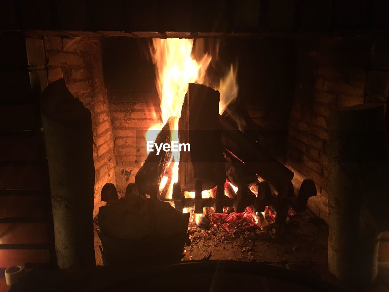 fire - natural phenomenon, burning, flame, heat - temperature, fireplace, bonfire, religion, indoors, spirituality, real people, night