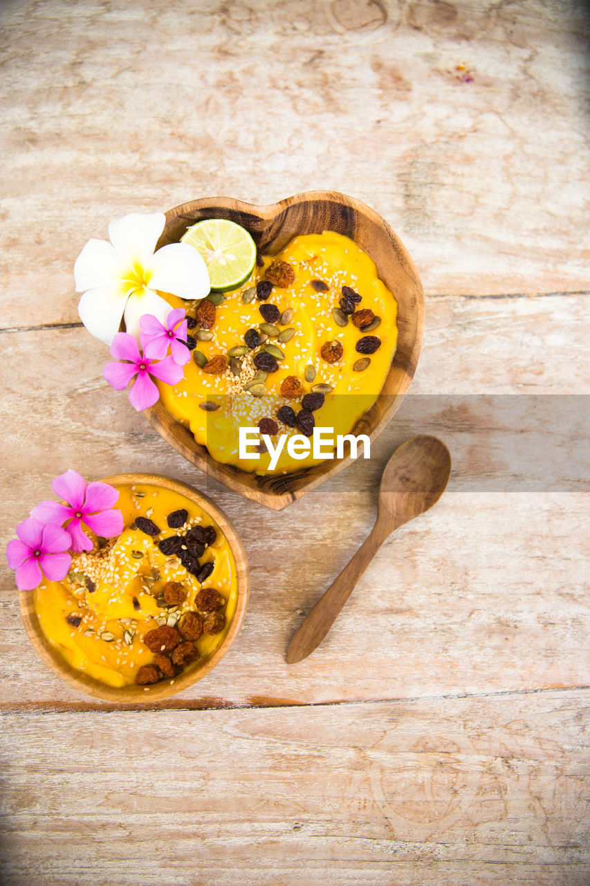 flower, freshness, petal, studio shot, no people, wood - material, high angle view, yellow, indoors, fragility, flower head, nature, close-up, beauty in nature, food, day