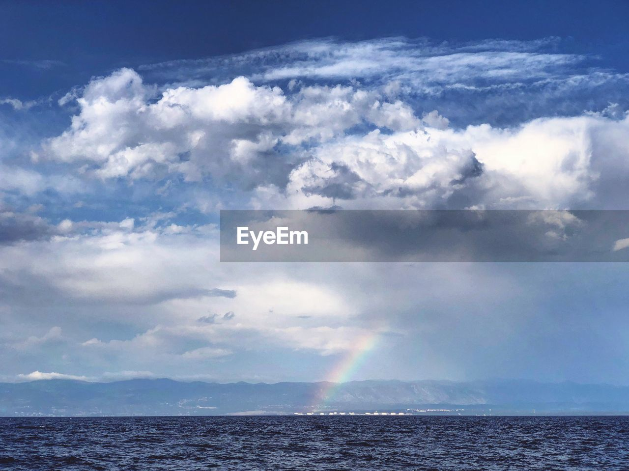 cloud - sky, sky, beauty in nature, sea, scenics - nature, water, horizon, horizon over water, nature, tranquility, tranquil scene, day, no people, outdoors, idyllic, rainbow, sunlight, waterfront, power in nature, ominous