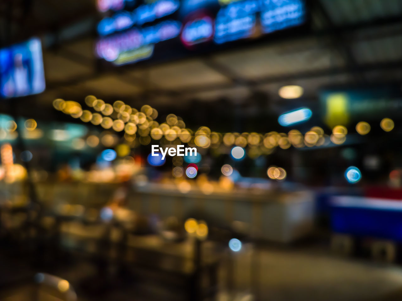illuminated, night, transportation, no people, glowing, lighting equipment, mode of transportation, defocused, architecture, city, focus on foreground, light - natural phenomenon, multi colored, indoors, motor vehicle, travel, motion, selective focus, airport, nightlife