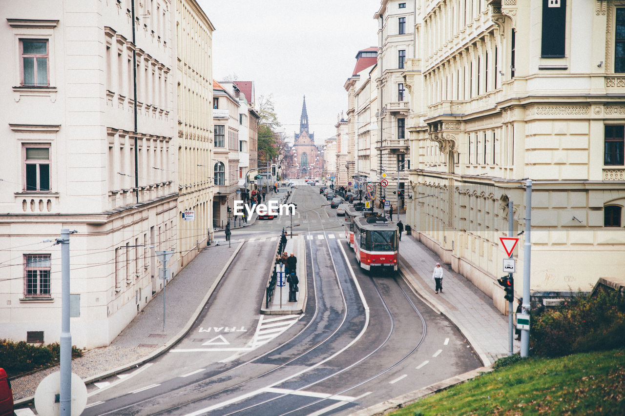 architecture, building exterior, road, transportation, city, built structure, street, car, outdoors, day, the way forward, land vehicle, group of people, large group of people, real people, people