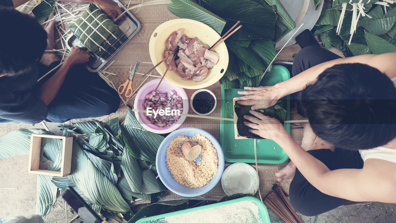 food and drink, food, table, high angle view, healthy eating, real people, fruit, breakfast, bowl, plate, directly above, lifestyles, freshness, togetherness, day, women, indoors, men, ready-to-eat, people