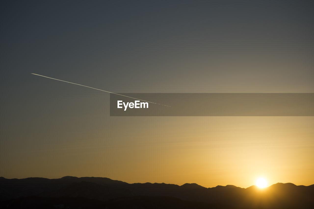 SCENIC VIEW OF VAPOR TRAILS IN SKY