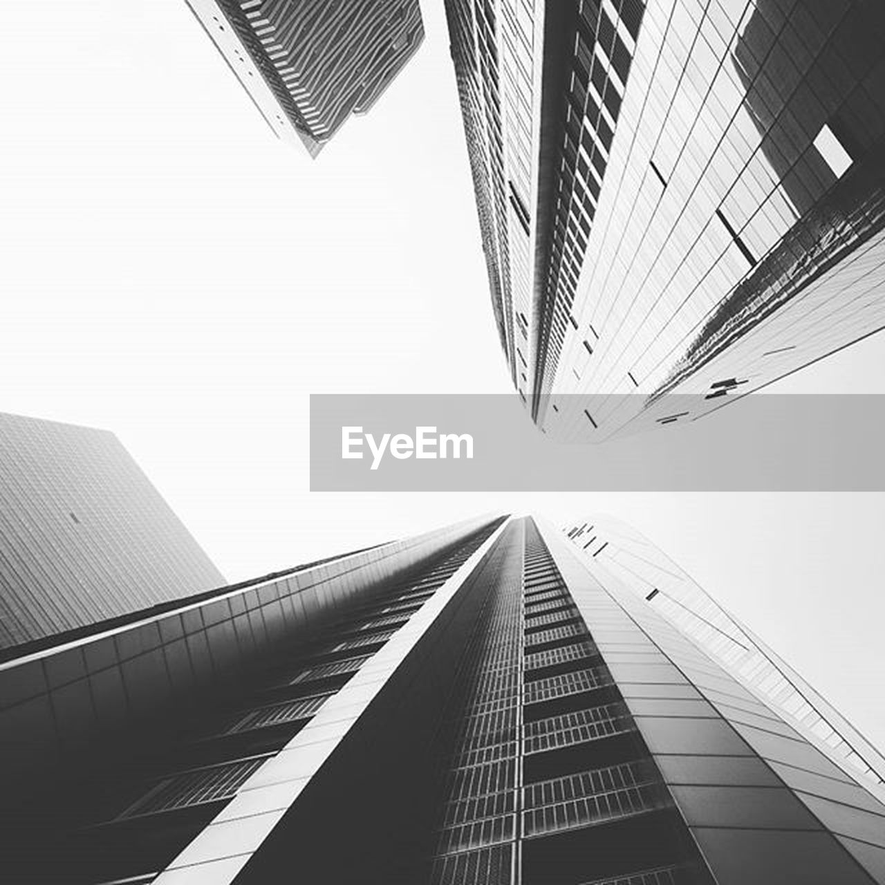 architecture, skyscraper, built structure, city, modern, building exterior, low angle view, day, futuristic, business, no people, downtown district, outdoors, office, corporate business, urban skyline, sky
