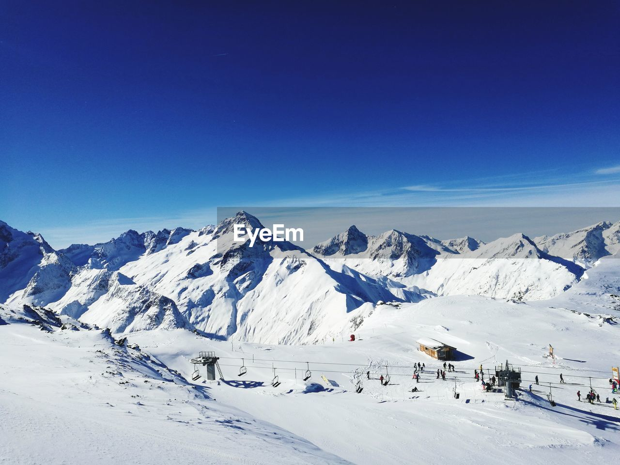 winter, cold temperature, snow, sky, mountain, scenics - nature, blue, beauty in nature, tranquil scene, tranquility, nature, non-urban scene, snowcapped mountain, white color, copy space, day, mountain range, environment, clear sky, outdoors