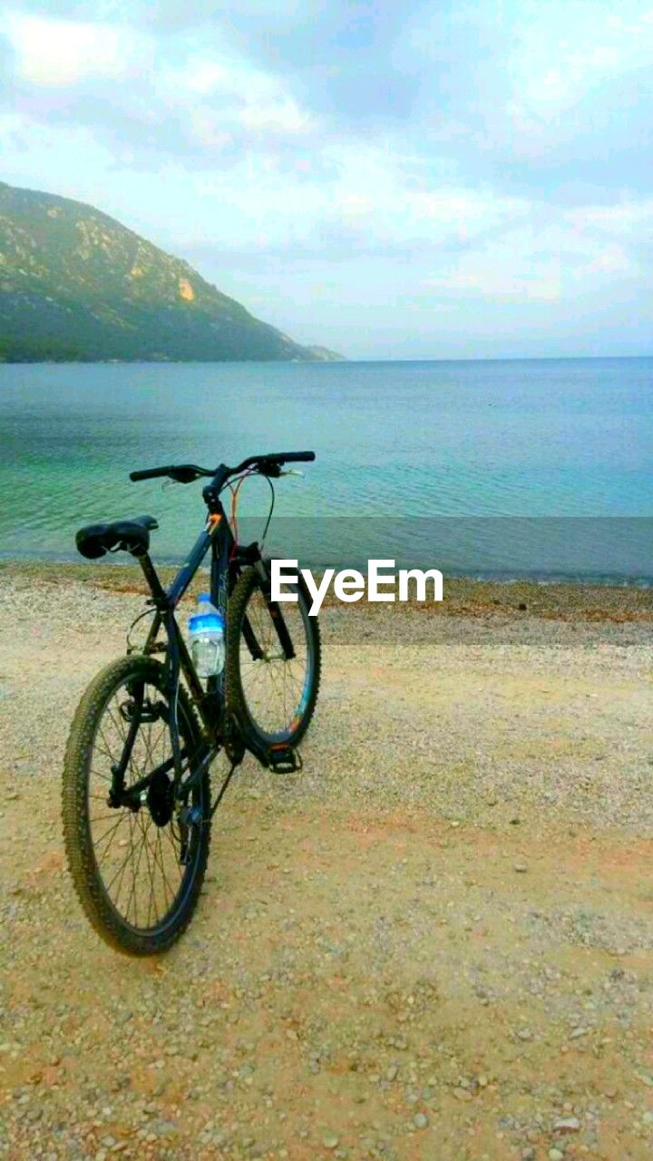 bicycle, sea, horizon over water, transportation, sky, nature, water, outdoors, beach, scenics, day, no people, beauty in nature