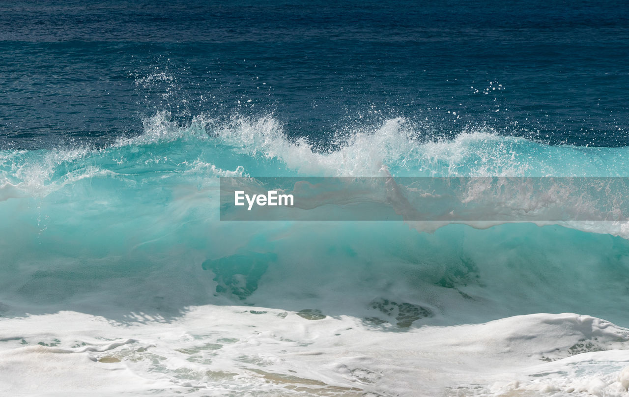 Frozen motion of water droplets at the crest of ocean waves off the coast of hawaii