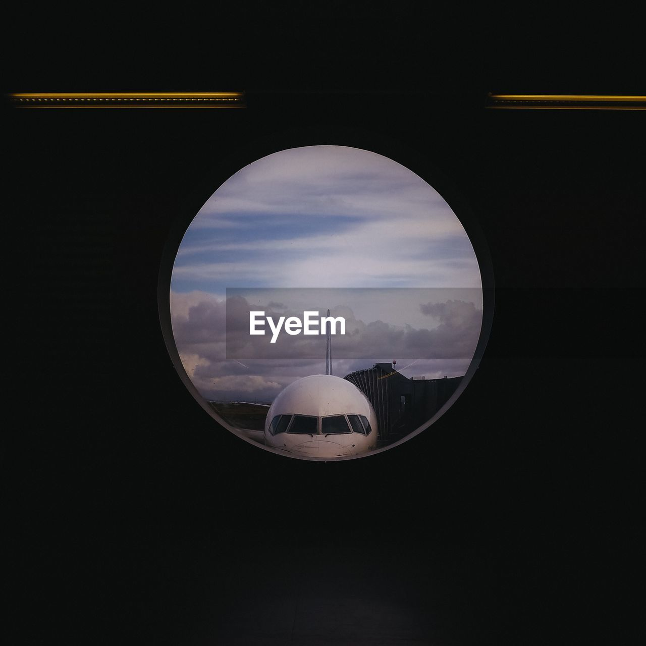 Close-Up Of Airplane Seen Through Window