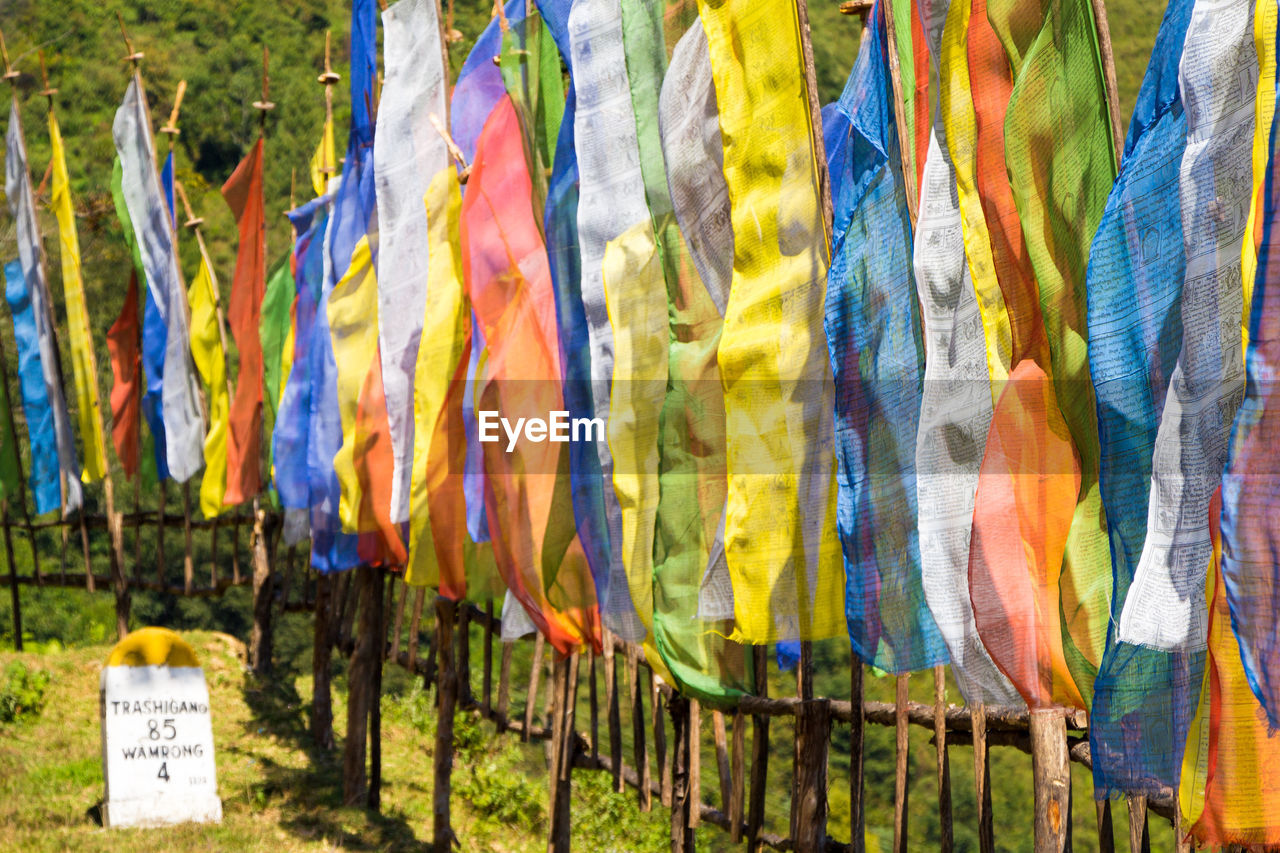 multi colored, hanging, no people, day, variation, textile, choice, in a row, pattern, nature, art and craft, outdoors, creativity, large group of objects, close-up, retail, environment, abundance, scarf