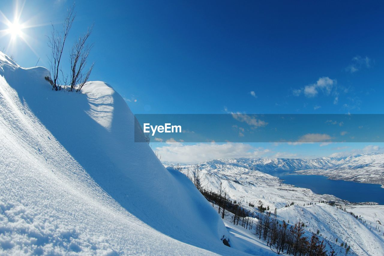 winter, snow, cold temperature, nature, white color, beauty in nature, tranquil scene, weather, sunlight, scenics, tranquility, mountain, outdoors, day, sky, blue, no people