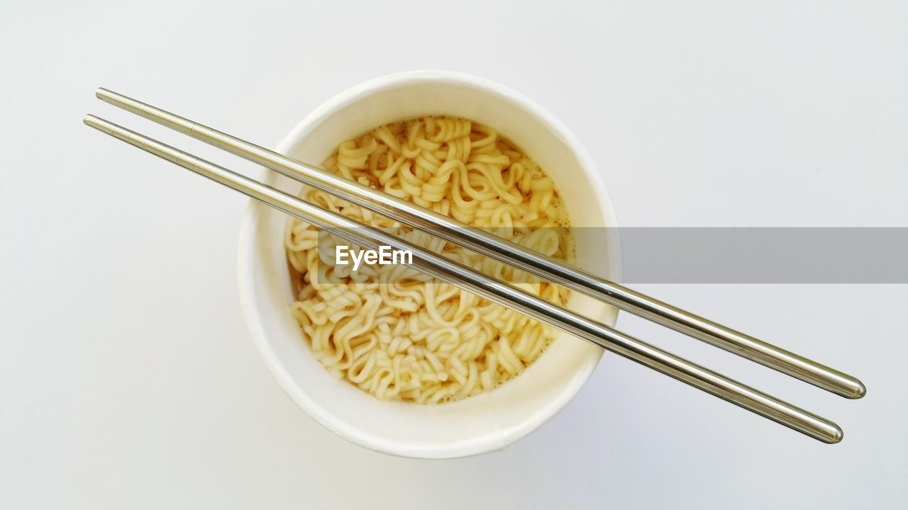 food, food and drink, studio shot, pasta, indoors, chopsticks, ready-to-eat, freshness, high angle view, white background, italian food, bowl, close-up, still life, no people, kitchen utensil, cut out, directly above, wellbeing, eating utensil, snack, chinese food, temptation, crockery