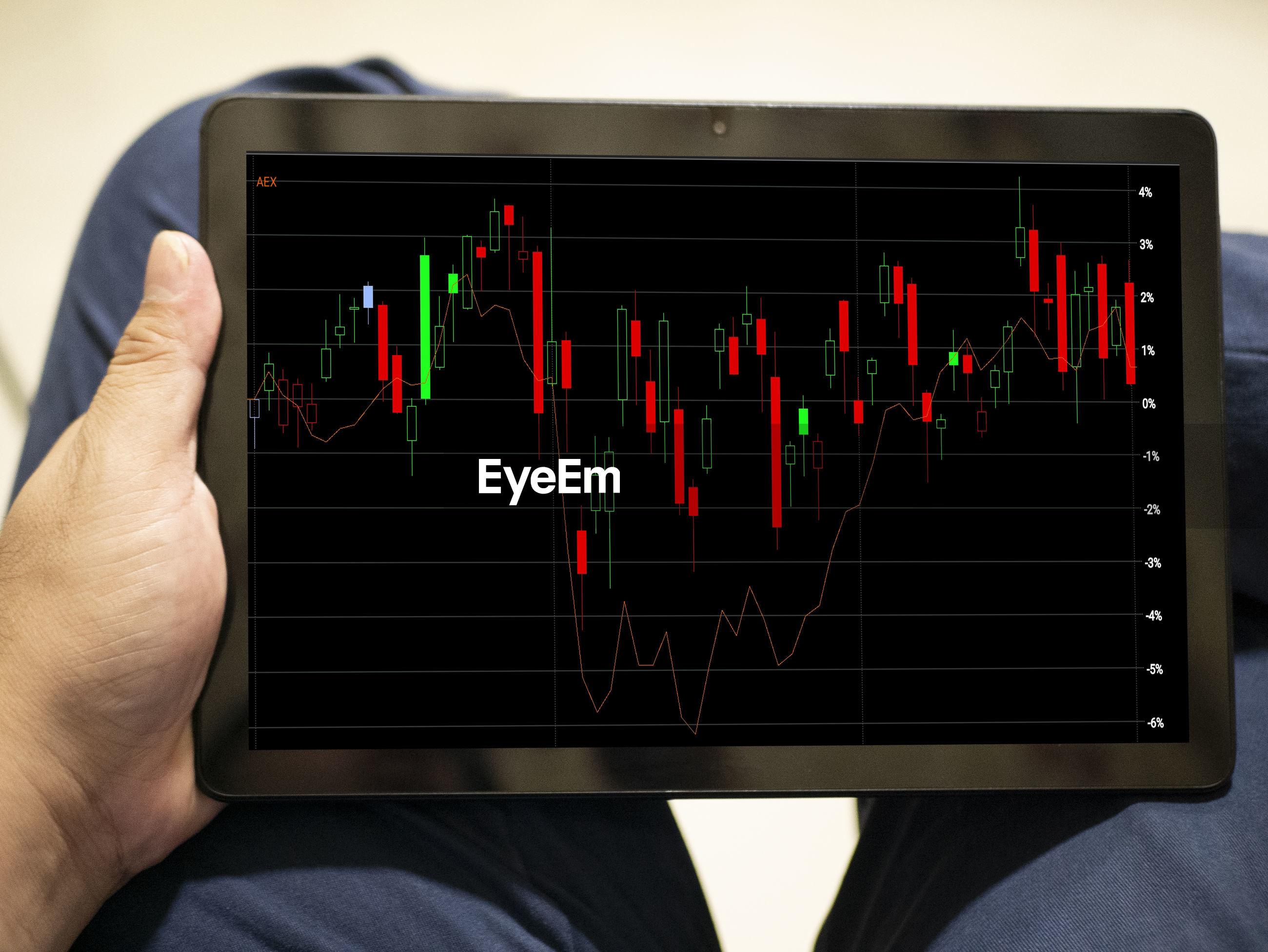 Cropped image of businessman holding digital tablet
