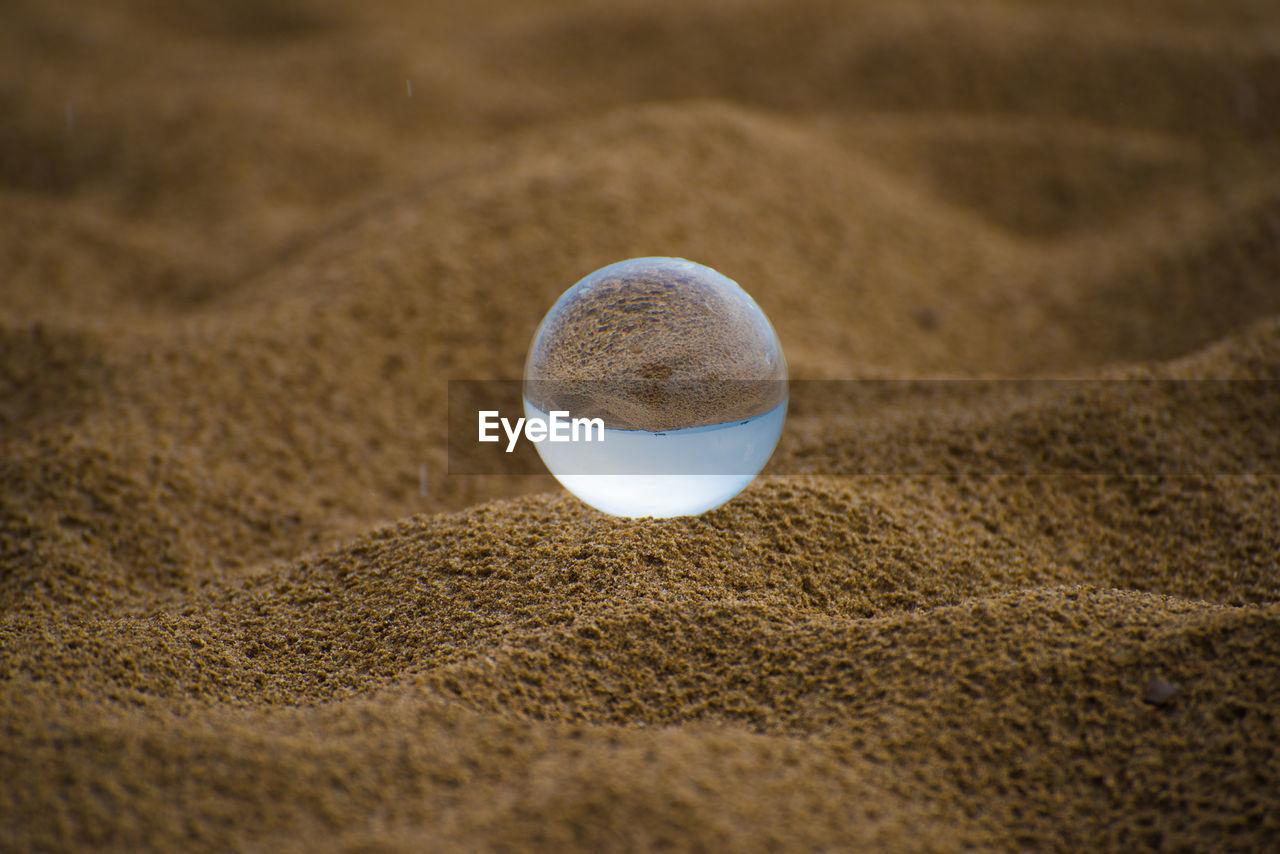 CLOSE-UP OF BALL ON BEACH