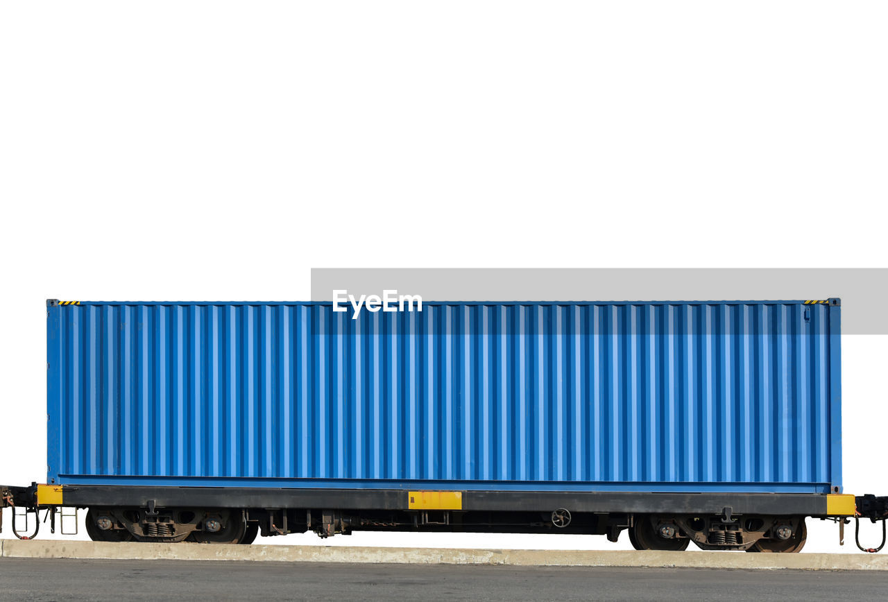 transportation, freight transportation, cargo container, container, mode of transportation, business, land vehicle, shipping, industry, truck, copy space, no people, outdoors, day, blue, delivering, sky, vehicle trailer, trucking, motor vehicle, consumerism