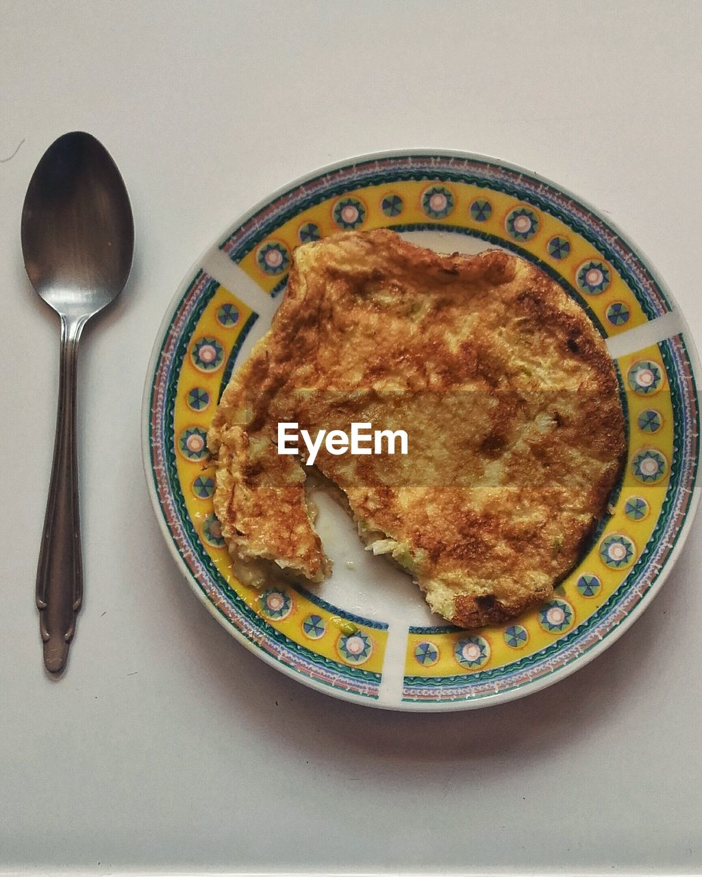 High angle view of omelet in plate on table