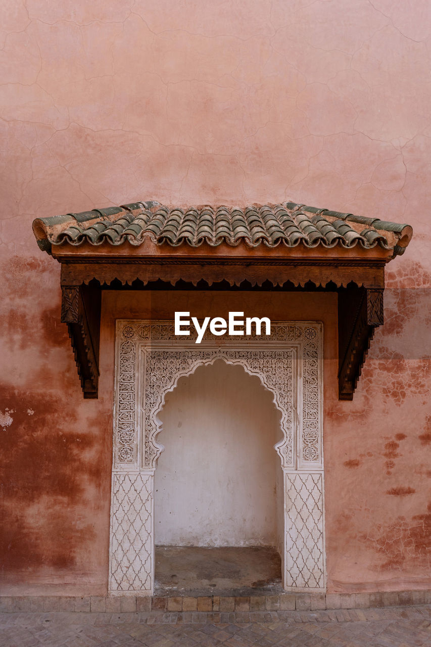architecture, built structure, the past, history, no people, wall - building feature, building exterior, old, entrance, ancient, day, building, nature, travel destinations, arch, door, outdoors, pattern, carving - craft product, ancient civilization, ornate