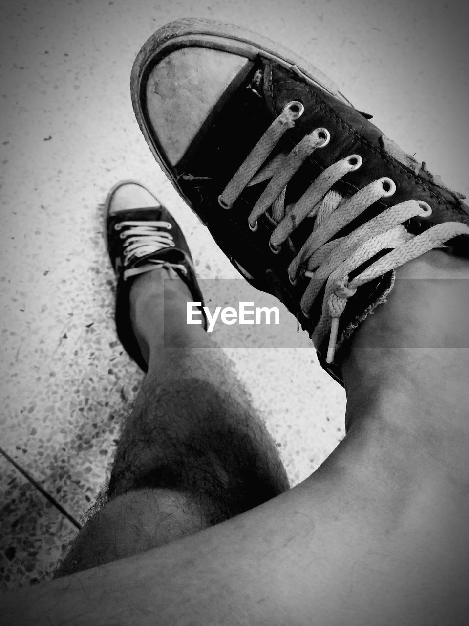 real people, low section, one person, human leg, shoe, personal perspective, human body part, human foot, high angle view, standing, men, lifestyles, canvas shoe, close-up, day, indoors, people