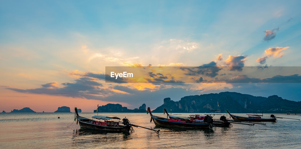 nautical vessel, sky, transportation, mode of transportation, cloud - sky, beauty in nature, sunset, water, scenics - nature, waterfront, nature, orange color, tranquility, idyllic, sea, tranquil scene, longtail boat, outdoors, non-urban scene, fishing boat