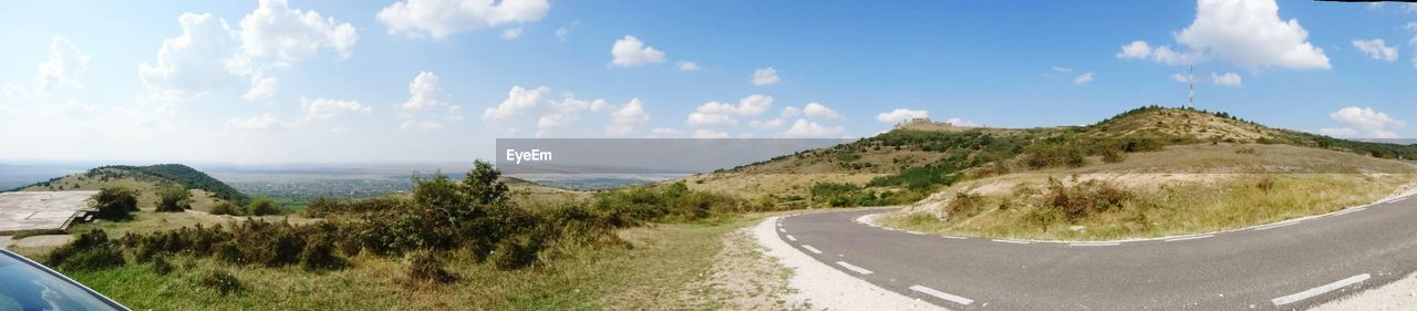 PANORAMIC VIEW OF WINDING ROAD AGAINST SKY