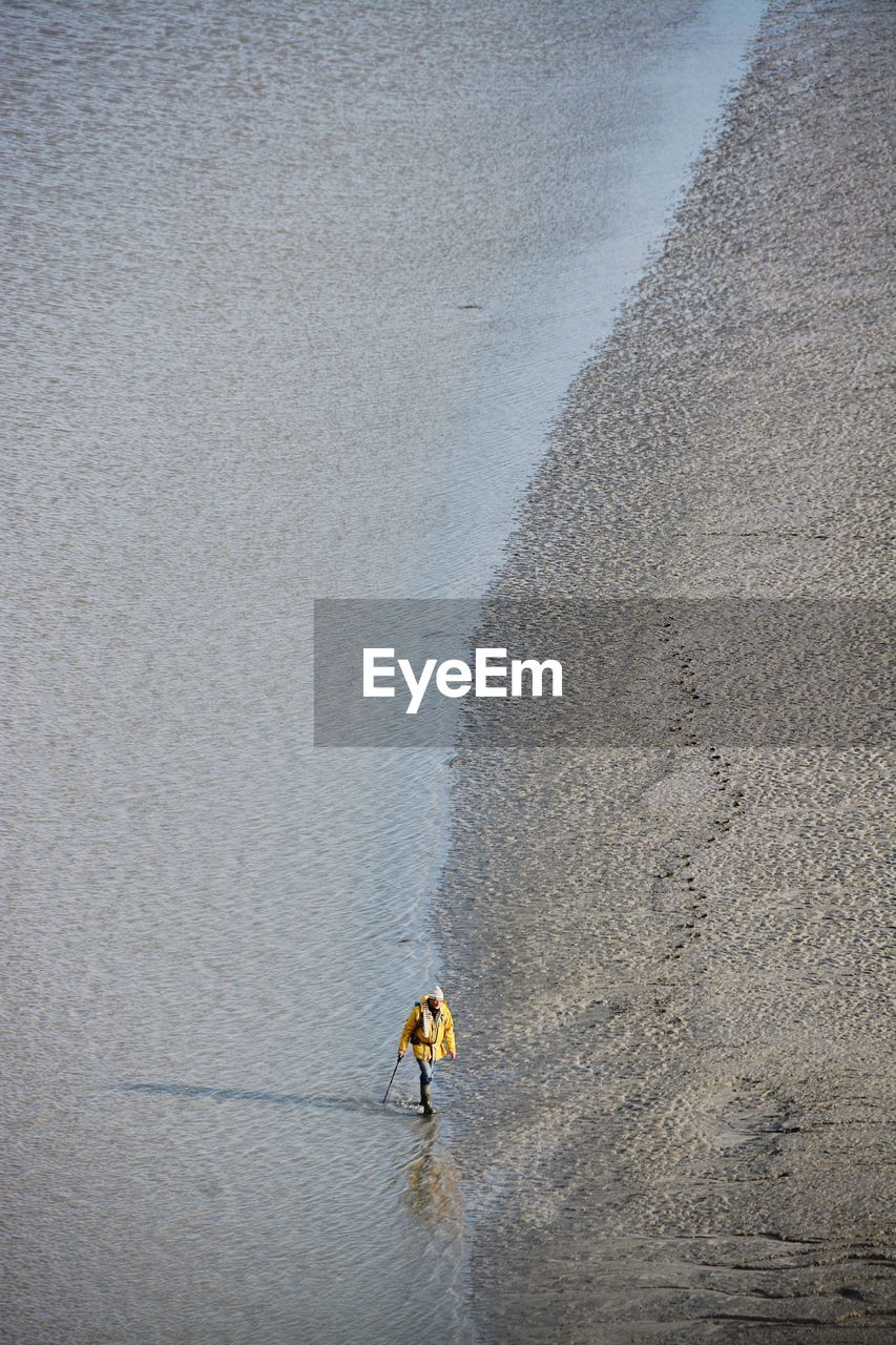 High angle view of person walking on shore at beach