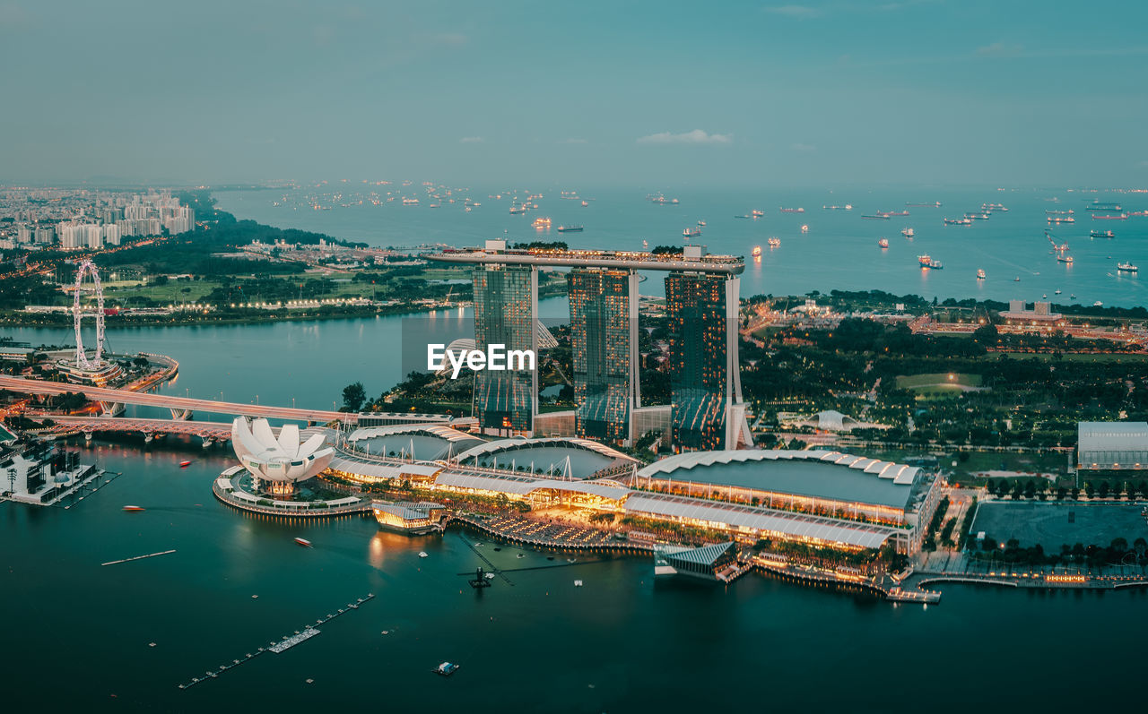 architecture, built structure, water, transportation, building exterior, no people, high angle view, waterfront, city, nautical vessel, cityscape, travel destinations, outdoors, illuminated, day, sky