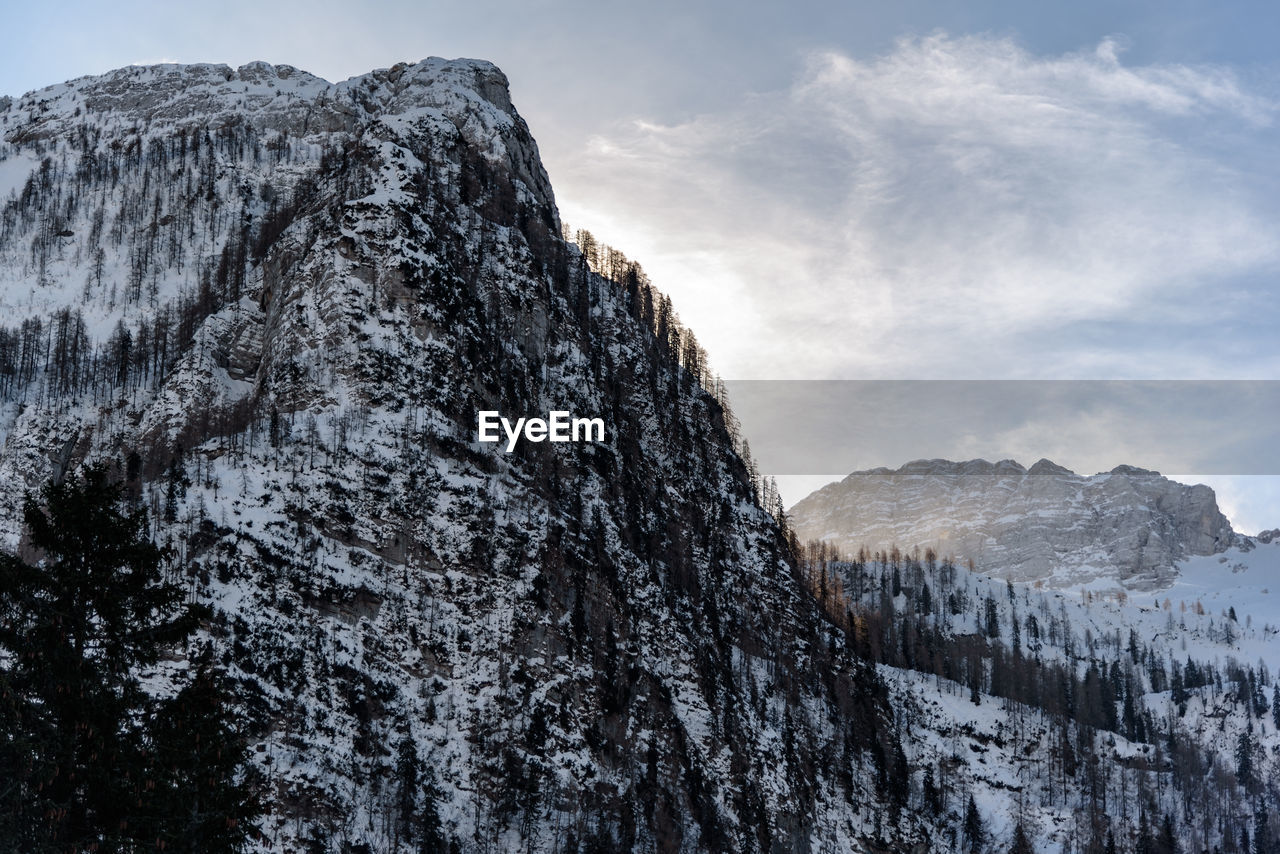 mountain, beauty in nature, scenics - nature, snow, sky, winter, cold temperature, tranquility, tranquil scene, mountain range, non-urban scene, rock, nature, no people, day, rock formation, rock - object, solid, environment, formation, outdoors, mountain peak, snowcapped mountain
