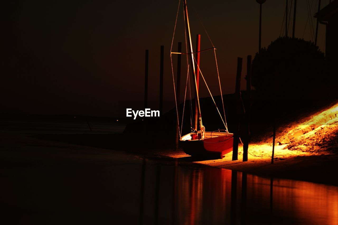 Boat Moored At Lake Shore During Night