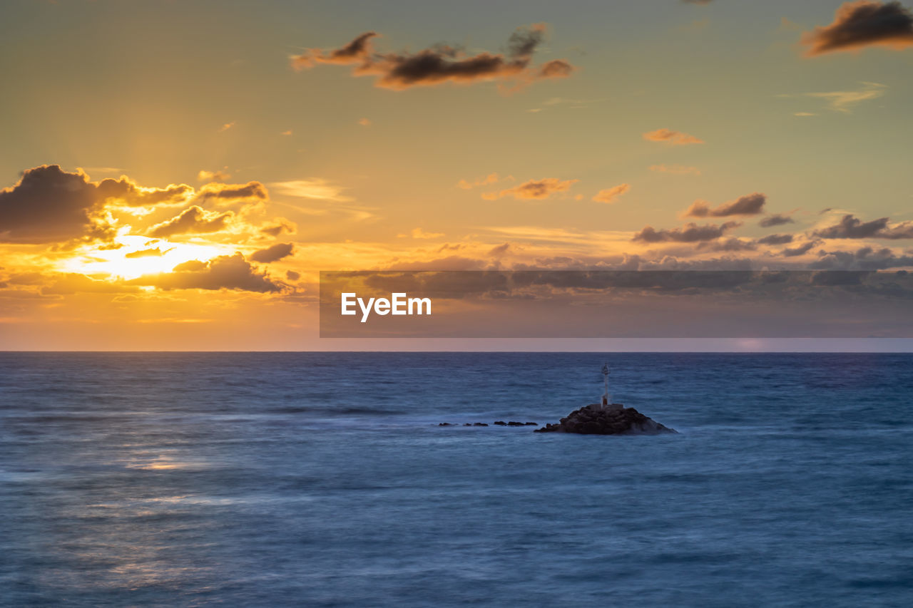 sky, sea, sunset, scenics - nature, horizon over water, water, beauty in nature, horizon, cloud - sky, tranquility, tranquil scene, waterfront, idyllic, orange color, nature, no people, land, non-urban scene, beach, outdoors