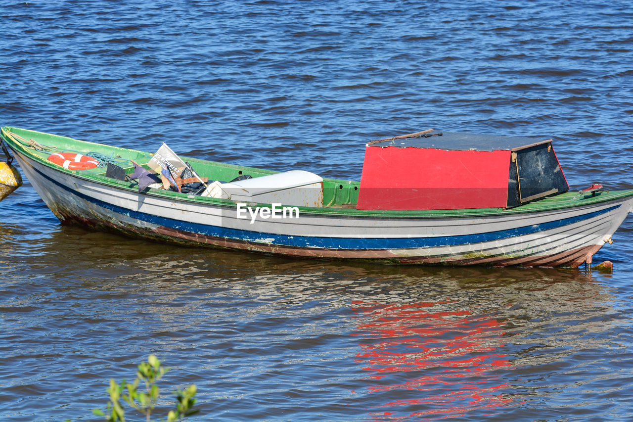 nautical vessel, water, mode of transportation, transportation, no people, moored, day, nature, waterfront, rippled, sea, outdoors, tranquility, travel, blue, reflection, beauty in nature, fishing boat, anchored, rowboat