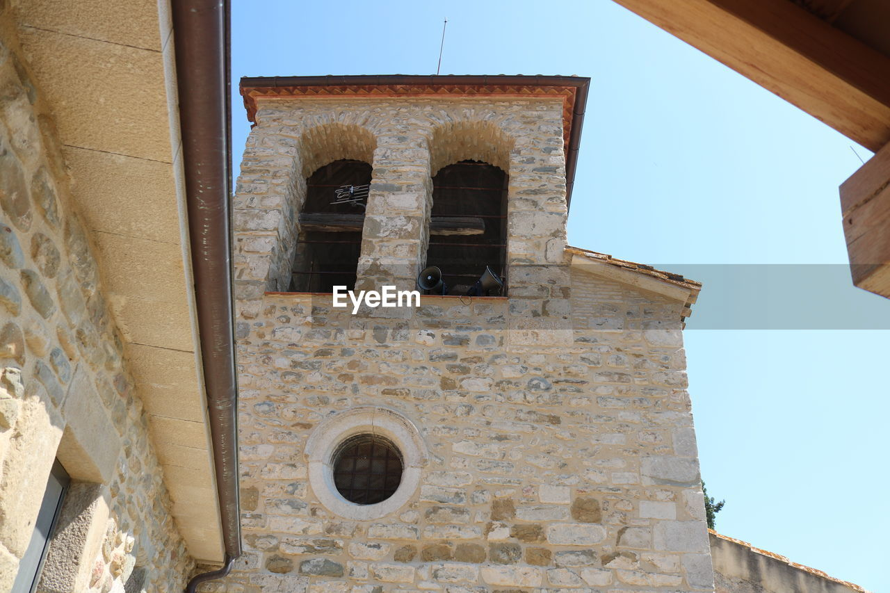 architecture, built structure, low angle view, sky, building exterior, clear sky, old, building, history, day, the past, window, no people, nature, outdoors, abandoned, place of worship, religion, wall - building feature, belief, ancient civilization