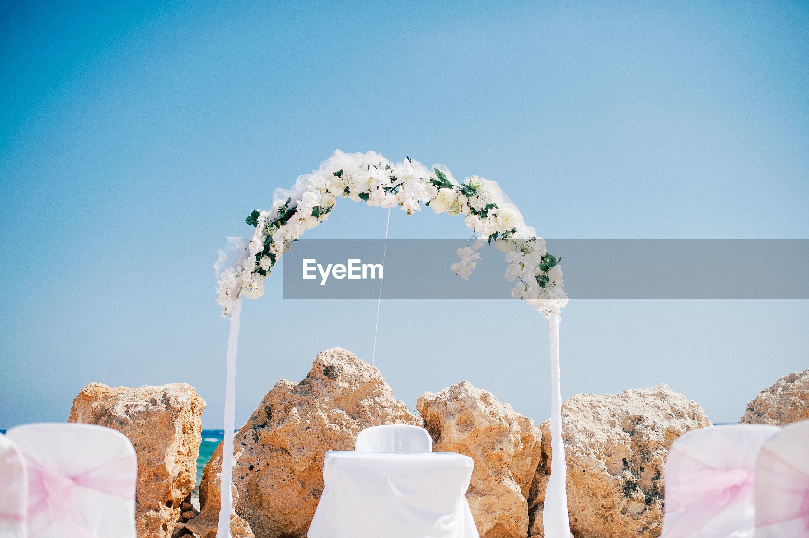 Wedding decoration by rocks at beach