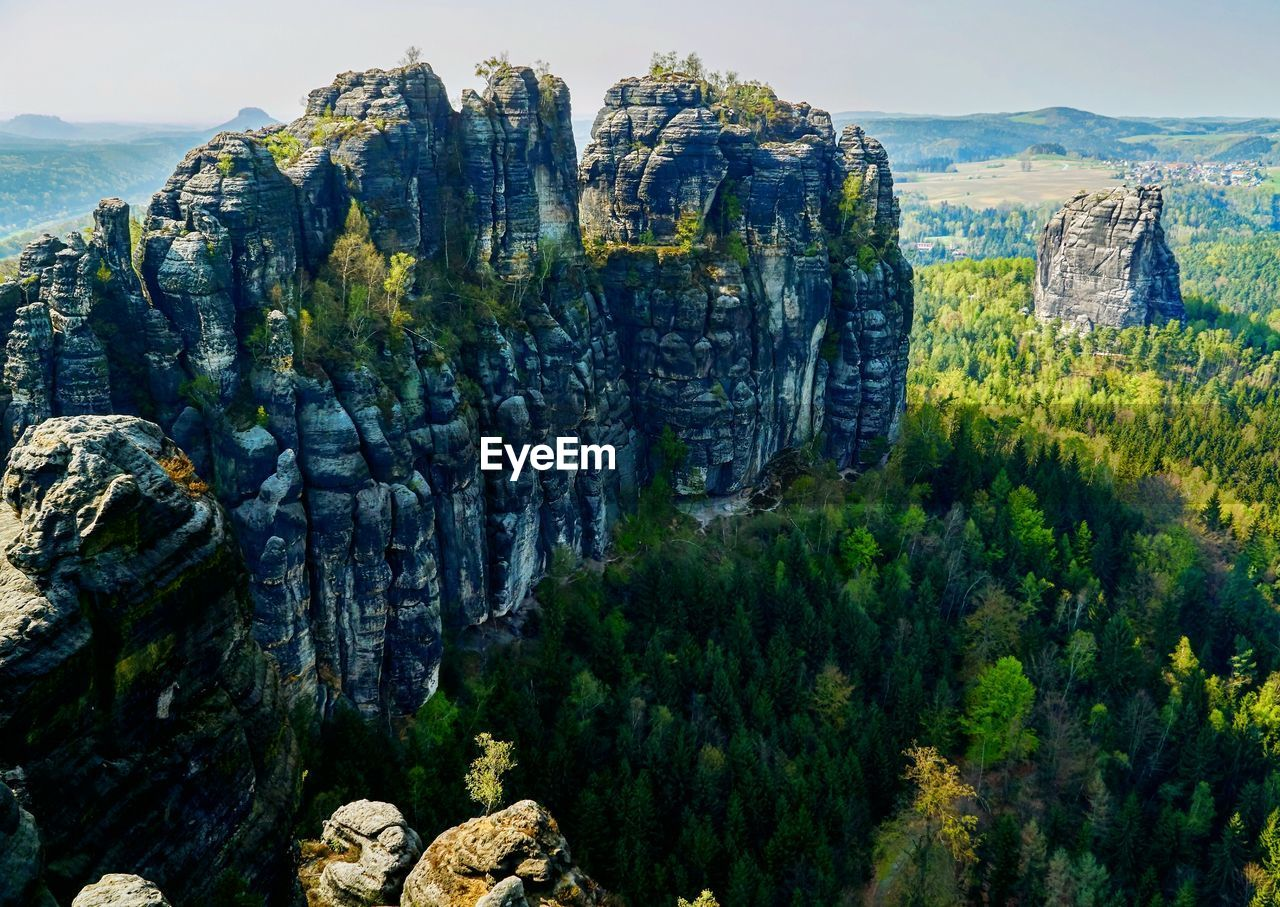 rock, beauty in nature, mountain, rock - object, solid, scenics - nature, rock formation, non-urban scene, nature, tranquil scene, landscape, plant, tranquility, environment, day, tree, geology, no people, mountain range, sky, outdoors, formation, eroded
