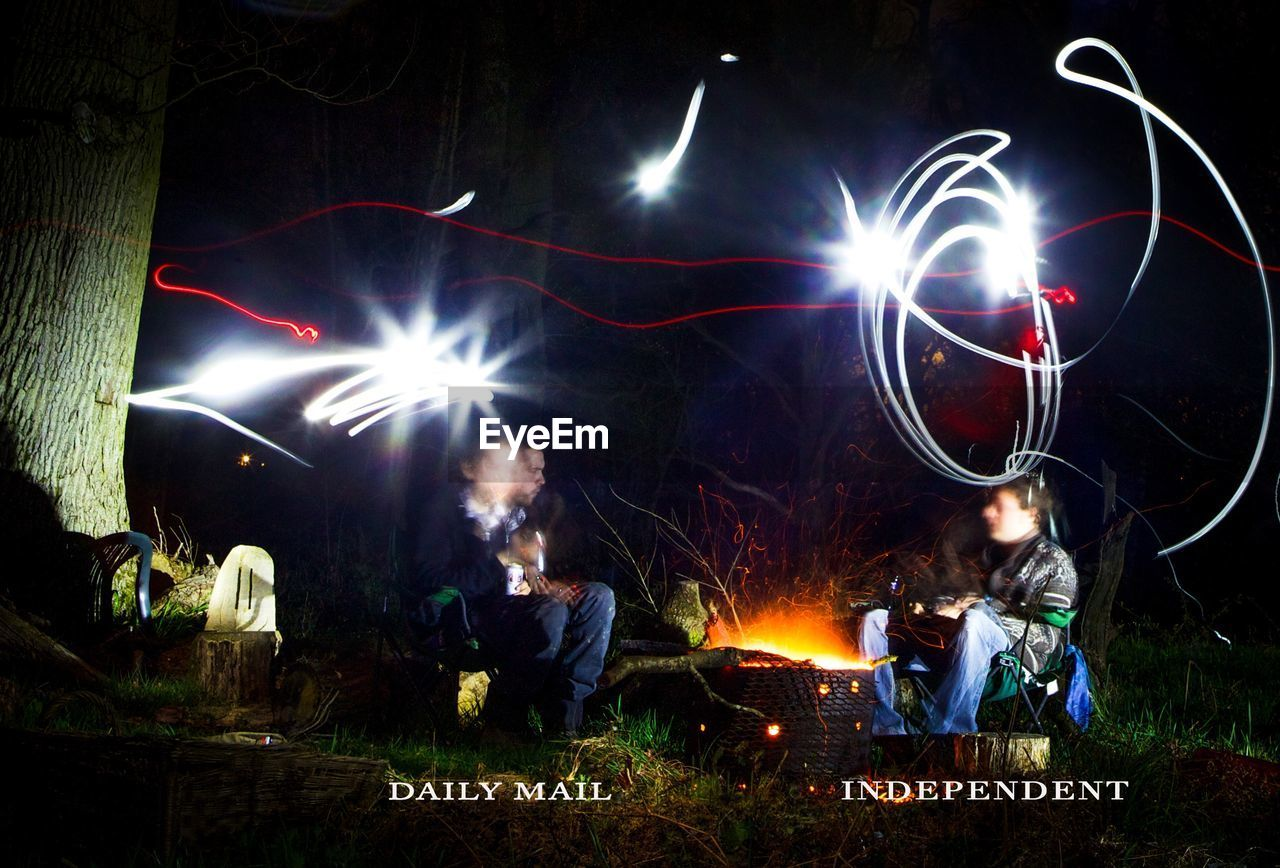 night, real people, illuminated, text, burning, outdoors, men, large group of people, women, togetherness, nature, people