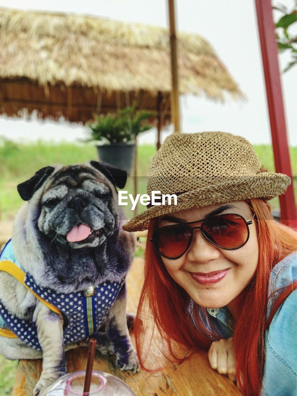 portrait, hat, one animal, glasses, headshot, canine, dog, domestic animals, pets, clothing, mammal, domestic, real people, leisure activity, lifestyles, looking at camera, one person, sunglasses, fashion, outdoors, warm clothing, pet owner