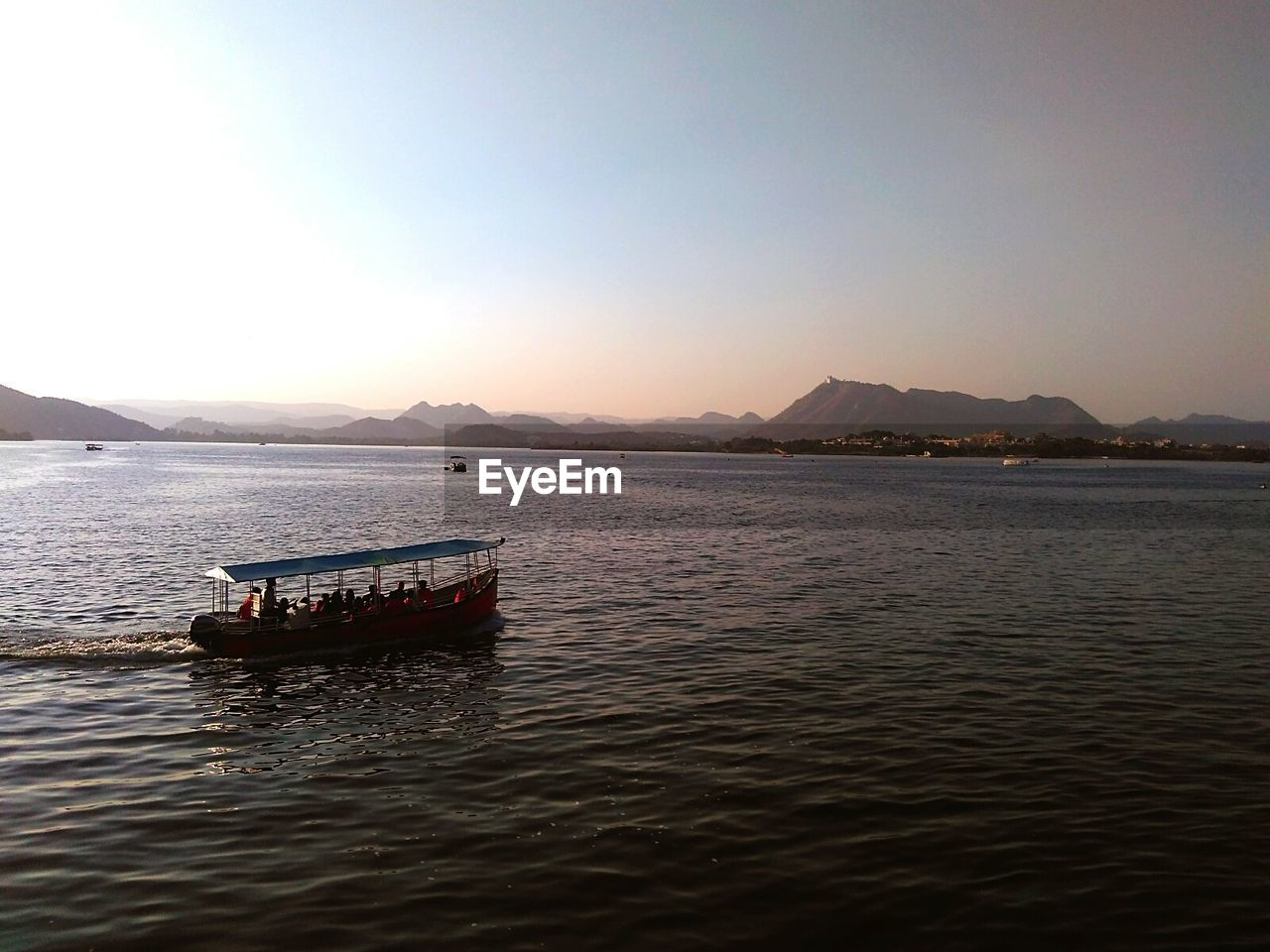 water, mountain, scenics, beauty in nature, transportation, nature, nautical vessel, tranquil scene, tranquility, copy space, waterfront, outdoors, clear sky, no people, sea, day, sky