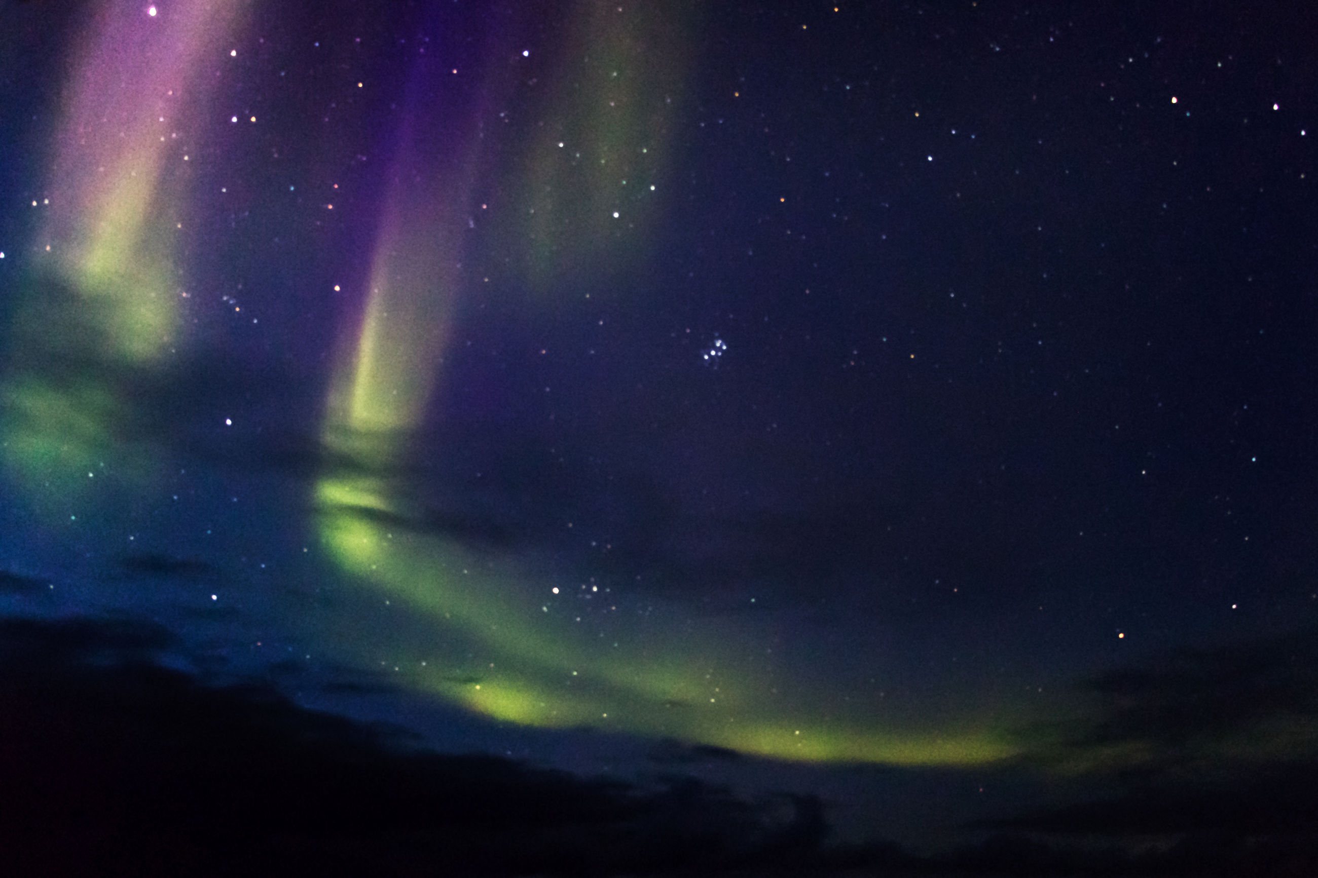 Northern boreal lights at sea in the northwest passage, canada.