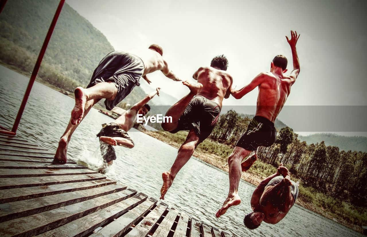 togetherness, outdoors, friendship, fun, real people, summer, men, leisure activity, full length, day, adventure, water, young adult, people, nature, adult, sky, adults only