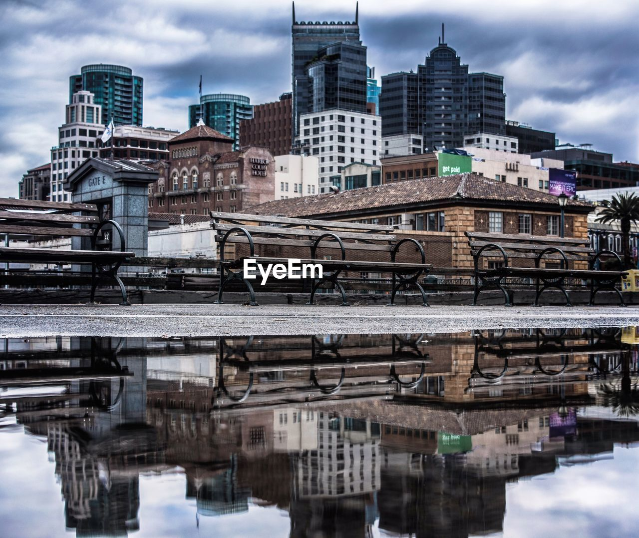 building exterior, architecture, built structure, sky, outdoors, reflection, waterfront, day, cloud - sky, city, water, skyscraper, no people, travel destinations, nature