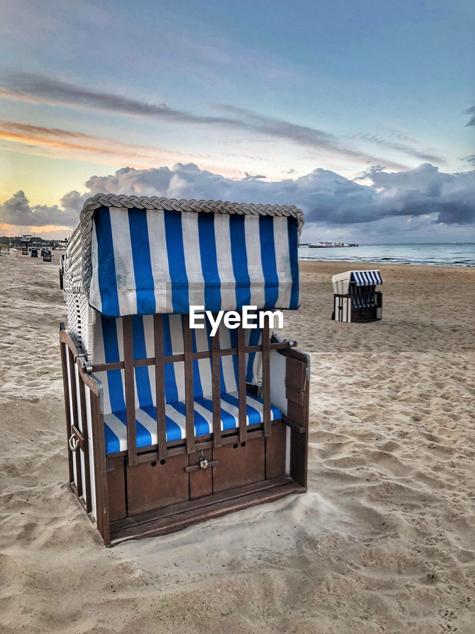 land, sky, beach, sea, scenics - nature, water, tranquil scene, cloud - sky, sand, tranquility, beauty in nature, chair, nature, absence, no people, hooded beach chair, non-urban scene, holiday, vacations, outdoors, horizon over water