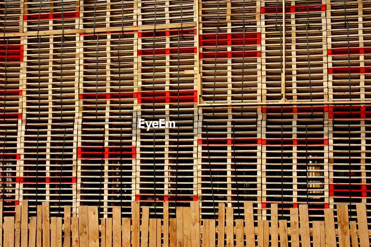 full frame, backgrounds, pattern, no people, repetition, built structure, indoors, red, close-up, architecture, metal, industry, wood - material, textured, day, in a row, wall, grid, abundance